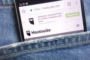 hootsuite website displayed on smartphone hidden in jeans pocket