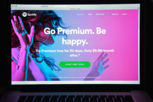 A computer screen advertising Spotify Premium subscription service.