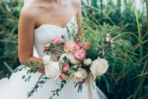 Girl in a wedding dress with beautiful flowers