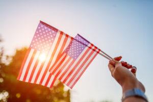 Waving the American flag- Trump campaign vs Biden Campaign