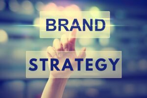 hand pointing at brand strategy text