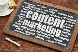 content marketing strategy word cloud on a digital tablet with a cup of coffee