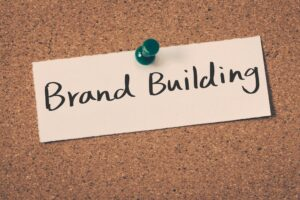 branding or brand building concept in piece of paper pinned