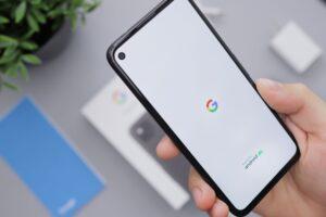 marketing concept image of smartphone opening Google app